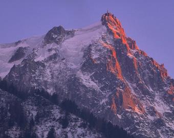 Fire mountain - Canvas print of the famous Aiguille du Midi lit up in the evening 100 cm x 70 cm