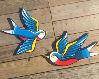 Wood panel swallow birds