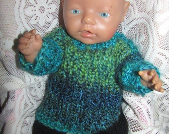 Knitted dolls clothes.