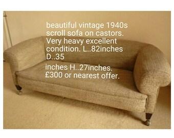 Vintage 1940s beige scroll arm sofa on castors