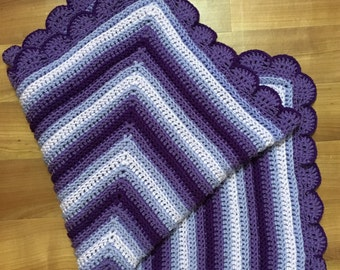 Crocheted ombré purple baby blanket