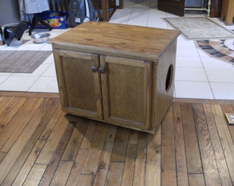 A Kitty Litter Box converted from a TV entertainment center.