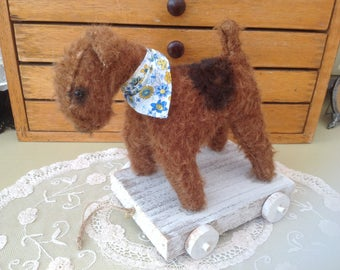 Arry the Airedale Dog made with Steiff Mohair and recycled wood.