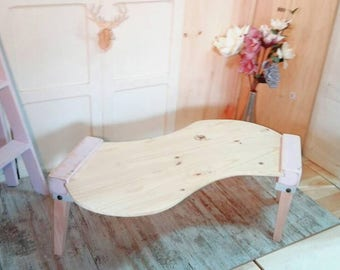 Living room coffee table, coffee table sofa shape curve, pine wood, angled legs there, Nordic-style design author, pink bat