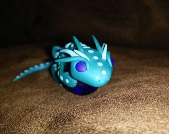 Blue Dragon holding an Orb Polymer Figurine