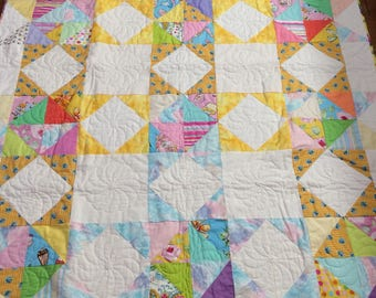 Twin size bed quilt / yellow print / white squares / half triangles / multi-colored / yellows, blues, pinks