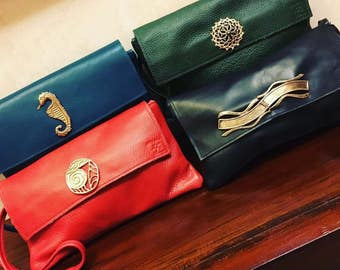 Italian leather clutch with bronze handmade items.
