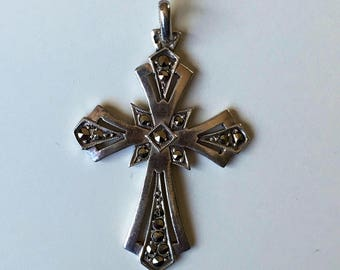 Vintage silver cross with shiny iron stone inlay