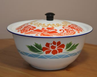Bumper Harvest metal enameled bowl with lid made in China.