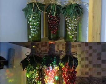 Glass bottle with grapes -  Red, Green and Pink with lights