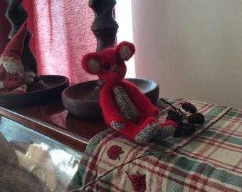Red wool felt bear needle felted using pure wool and given tartan paws and tummy .