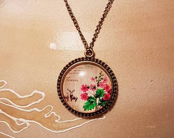 Vintage pendant with flowers