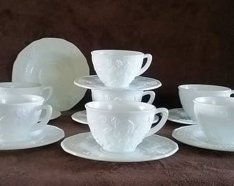 Seven cups and Eight Saucers in the Colony  Harvest Grape Pattern by Indiana Glass Gifts and Home Decor Milk Glass