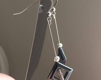Silver and black dangle earrings
