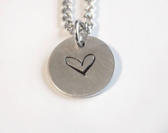 Metal stamped heart pendant necklace