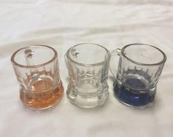 Vintage shot glasses - shape like beer mugs: 1 clear, 1 golden, 1 blue