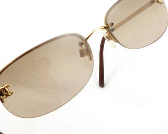 AUTH. CHANEL brown and gold logo Sunglasses. Vintage designer sunglasses.