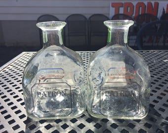 A set of idled Patron bottles