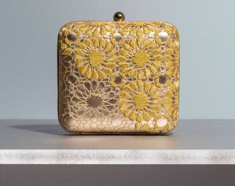 arabesque box clutch