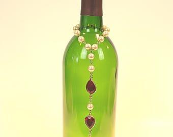Elegant faux pearl and stone burner.
