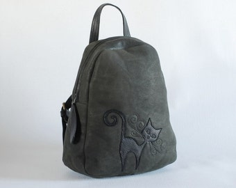 Backpack with black cat