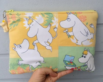 Pretty zippered yellow green pouch and a charm with Moomin Snorkmaiden