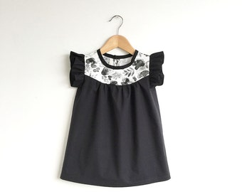 girls black cotton dress with floral detail