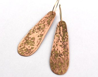 Long oval gold hammered copper earrings