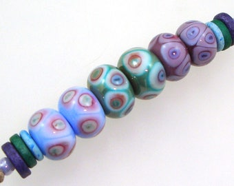 Handmade Lampwork Glass Beads - 3 pairs. Dot reactions on periwinkle, copper green & violet. Earring pairs, jewelry making supplies.