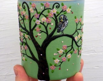 What's up? Burrowing owl and Spring Blossoming Apple Tree Sculpted with Polymer Clay onto a Recycled Glass Candle Holder in Sage Green