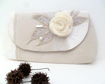 Monochromatic beige clutch, fiber art purse, beige fiber collage, embroidered, featured in Haute Handbags Spring 2017 issue