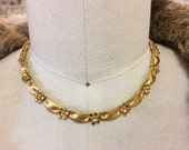 Vintage signed Trifari gold tone flower ribbon collar or choker necklace