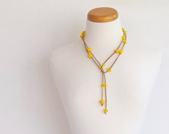 Resin bead lariat necklace lemon yellow resin chip shaped beads spaced along gold suede cord can be worn as a belt too