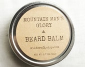 "Beard Balm.  ""Mountain Man's Glory"".  All natural scented beard moisturizer, protector, and taming product."
