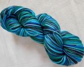 Self-Striping Teal, Emerald, Aqua, and Black Superwash Merino and Nylon Blend Sock Yarn:  Dragonfly