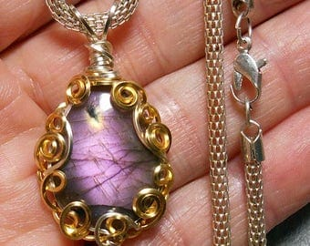 labradorite  pendant,  bright well centered magenta flash,  hand wrapped, silver and gold tone  filigree setting