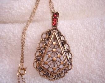 """Antique Gold Tone Filigree Red Stone Pendant. 2""""  x 1.25"""" Chain 16"""""""