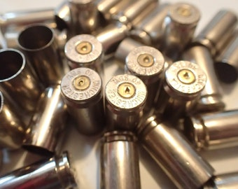 40 Caliber Nickel Empty bullet casings brass shells bullet casings brass shells bullet casings, rounds, cases, cartridges,