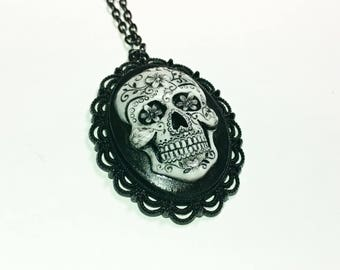 Sugar skull cameo necklace on 30 inch chain.