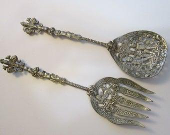 vintage figural brass serving set - ROSSI ITALY cherub brass with fleur de lis handles, marked ROSSI Italy, figural cherub serving pieces