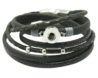 Mini Snap Bracelet will fit petite Ginger snaps charms plus other 12 mm snap buttons. Black Leather snap bracelet with magnetic closure.