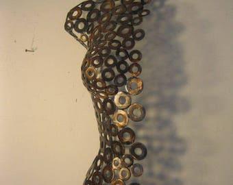 Female half torso, metal sculpture by Holly Lentz