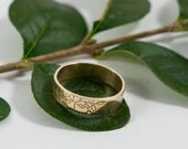 Gold Botanical Wedding Bands: A Set of his and his 9k gold wedding rings