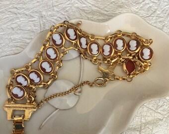 Cameo gold tone link bracelet .
