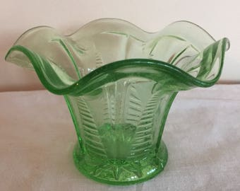 A small Art Deco style green pressed glass posy vase.