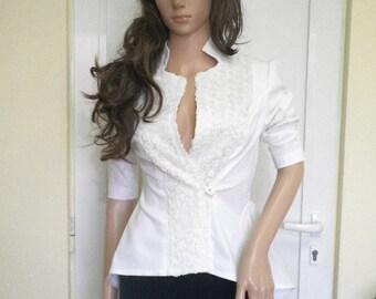 Elegant and stylish white women's jacket with 3 D lace.
