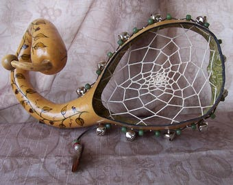 Medium natural gourd dreamcatcher tambourine with wood burned vines.   1947