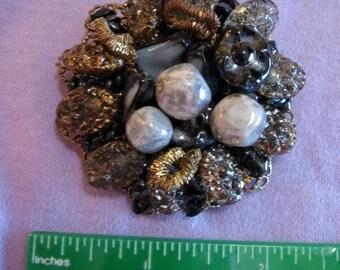 Ornate beaded brooch