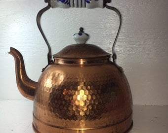 copper teapot with glazed blue and white handle