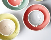 ceramic bowls set, mix and match, small and large pottery bowls, white and colourful, keepsake, trinket dish, serving bowl, nesting bowl.